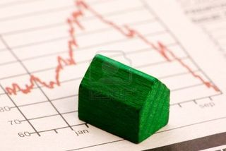 Housing-market-concept-image-with-graph-and-toy-house